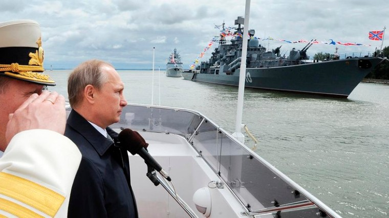 Russian President Vladimir Putin, second left, reviews a Navy parade in Baltiisk, western Russia, Sunday, July 26, 2015 during celebrations for Russian Navy Day. (Mikhail Klimentyev/RIA-Novosti, Kremlin Pool Photo via AP)