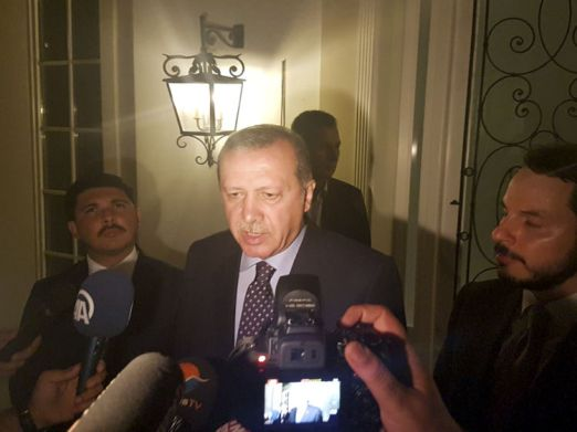 Turkish President Tayyip Erdogan speaks to media in the resort town of Marmaris, Turkey, July 15, 2016. REUTERS/Kenan Gurbuz - RTSI7A7