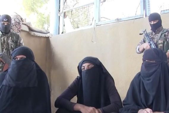 ISIS-fighters-captured-while-fleeing-besieged-town-dressed-as-women