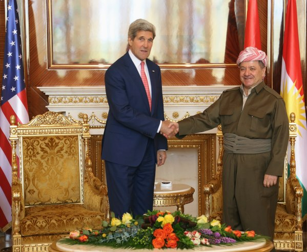 Kurdish Regional Government President Massoud Barzani (R) shakes hands with U.S. Secretary of State John Kerry (L) in Arbil, in Iraq's Kurdistan region June 24, 2014. Kerry was in Iraqi Kurdistan on Tuesday to urge its leaders not to withdraw from the political process in Baghdad after their forces took control of the northern oil city of Kirkuk. Peshmerga fighters, the security forces of Iraq's autonomous Kurdish north, seized control of Kirkuk on June 12 after the Iraqi military fled in the face of an onslaught from Sunni militants from the Islamic State in Iraq and the Levant (ISIL). REUTERS/Stringer (IRAQ - Tags: POLITICS)