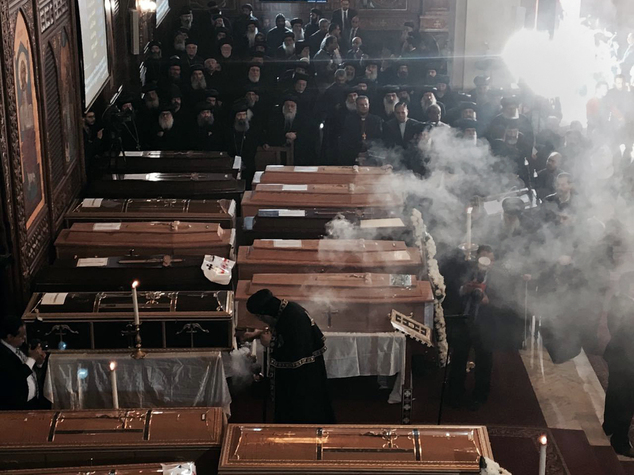 Coffins are laid out during a funeral service for victims of a Sunday cathedral bombing, at the Virgin Mary Church, in Cairo, Egypt, Monday, Dec. 12, 2016. Egyptians held prayers for 25 Christians killed the day before at a church next to the city's main Coptic cathedral in what was one of the deadliest attacks on the religious minority in recent memory. The bomb went off while worshippers were attending Sunday Mass at a chapel adjacent to St. Mark's Cathedral. The coffins of the 25 have been laid in front of the altar, with the names of each victim plastered on the side facing the congregation. (AP Photo/Nariman El-Mofty)