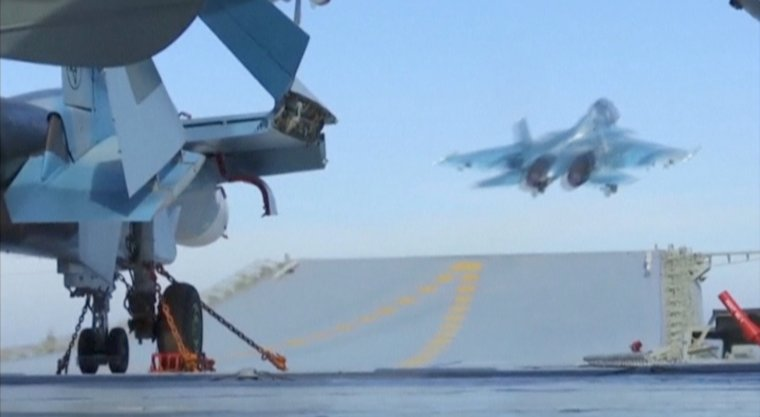 A still image taken from a video footage and released by Russia's Defence Ministry on November 15, 2016, shows a jet taking off from Russian Admiral Kuznetsov aircraft carrier near the coast of Syria. Ministry of Defence of the Russian Federation/Handout via REUTERS TV ATTENTION EDITORS - THIS PICTURE WAS PROVIDED BY A THIRD PARTY. FOR EDITORIAL USE ONLY. NO RESALES. NO ARCHIVE.